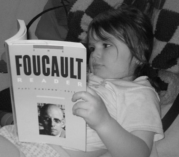 Foucault-reading-michel1